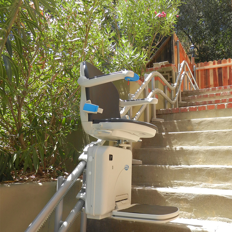 Kraus Handicare 2000 Outdoor exterior outside concrete floors double rail stair chair lift